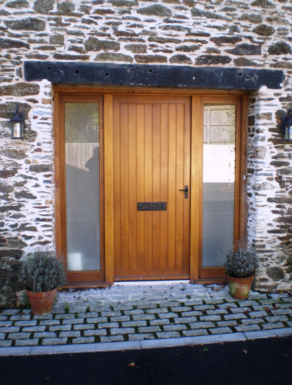 Refurbished barn front door for new house