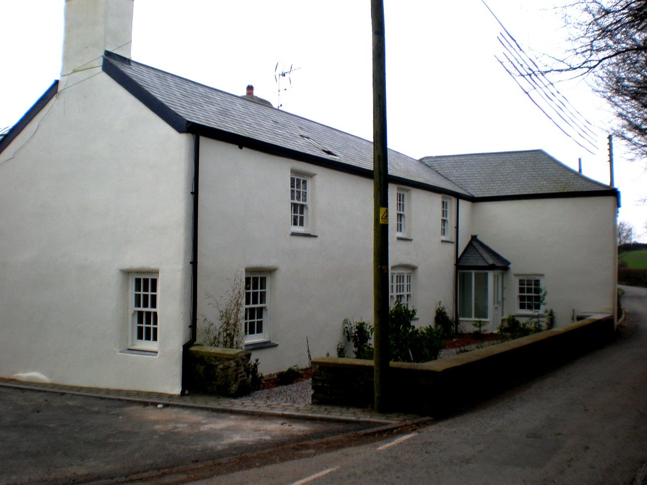 Refurbished farmhouse with lime render to walls
