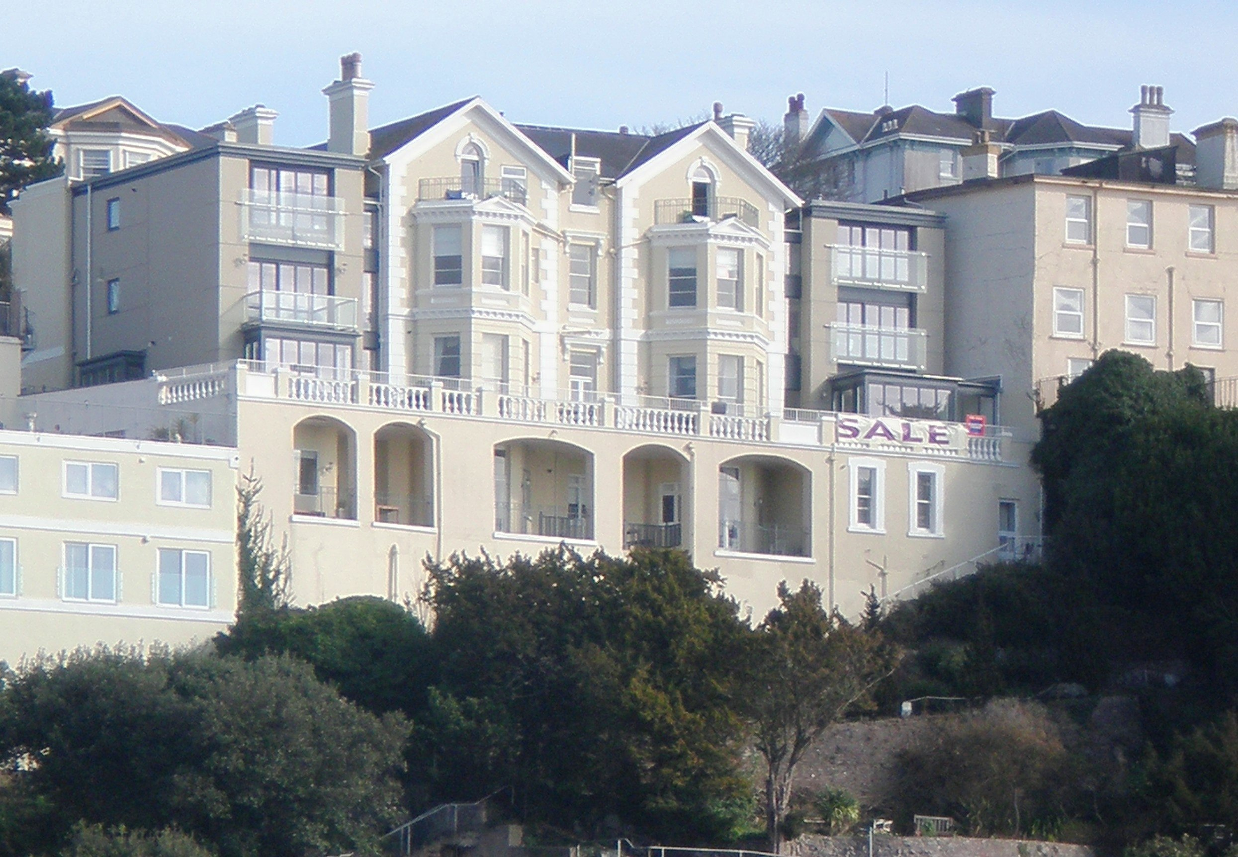 View of the rear of the apartment building overlooking Torquay marina and towards Brixham