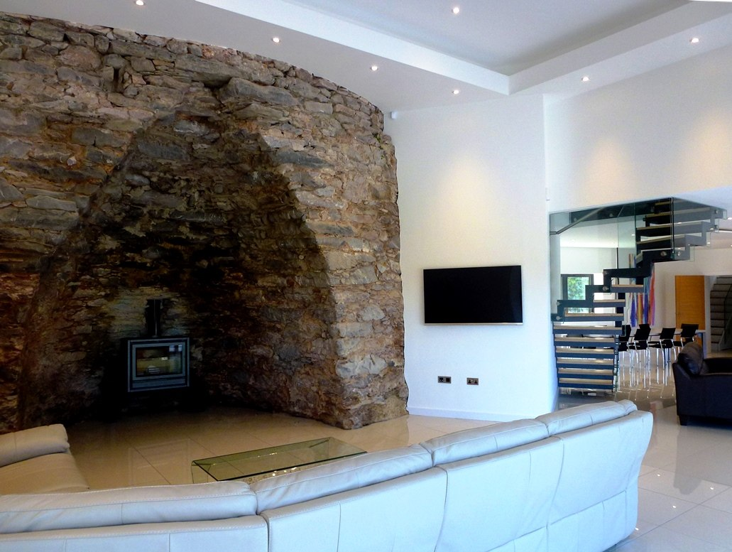The existing lime kiln retained in the building